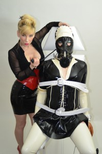 Picks of fully clothed women in bondage